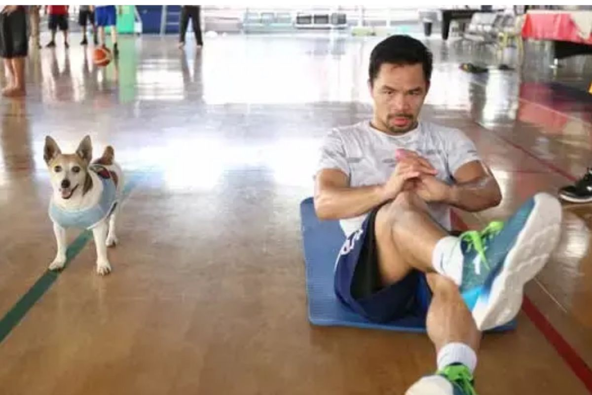 Pacman the dog and boxing champ Manny Pacquiao | Photo by WENDELL ALINEA/MP PROMOTUIONS